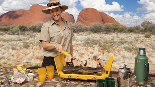Tour guide preparing food on the Kata Tjuta Domes Tour