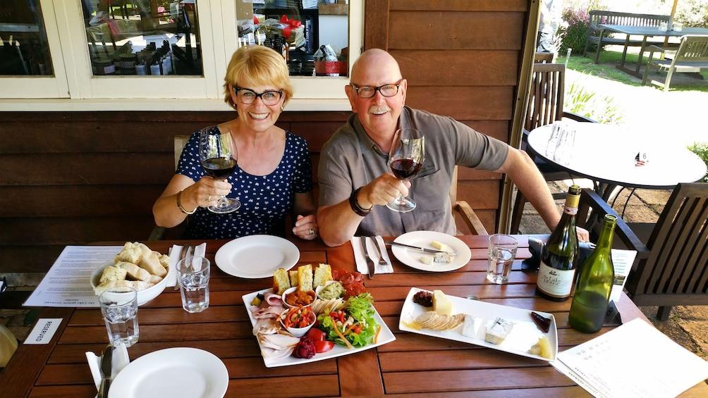 Couple enjoying glasses of wine with cuisine at The Lake House restaurant in Denmark, Australia