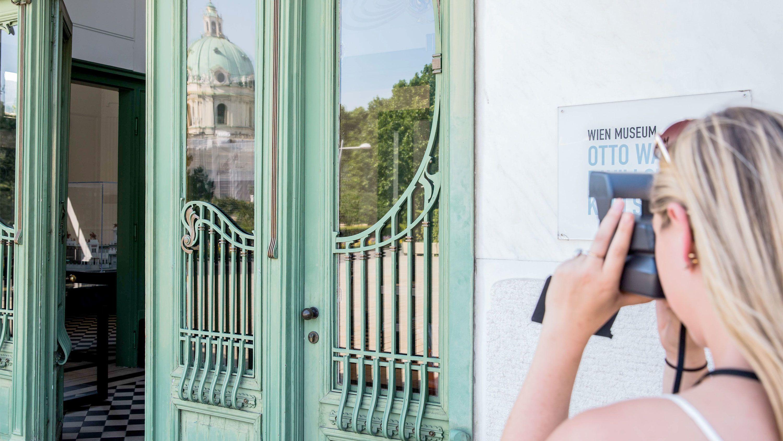Woman taking a polaroid photo at the Vienna State Opera