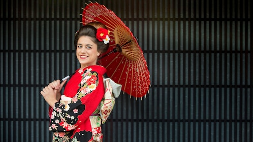Woman posing with umbrella in kimono in Kyoto