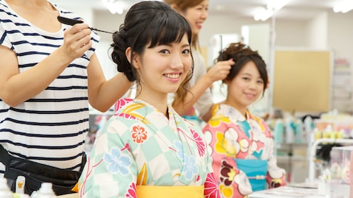 Women in kimonos having their hair done in Kyoto