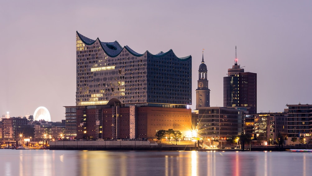 Show item 1 of 7. Elbphilharmonie concert hall shining at night in Hamburg