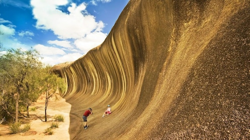 Tourists taking pictures at Wave Rock in York