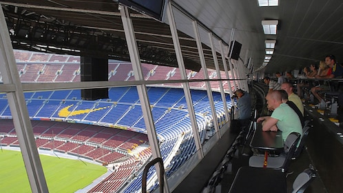 fans sitting in seats at football stadium in Barcelona