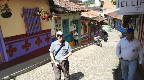 Tourist stands in street of Guatapé