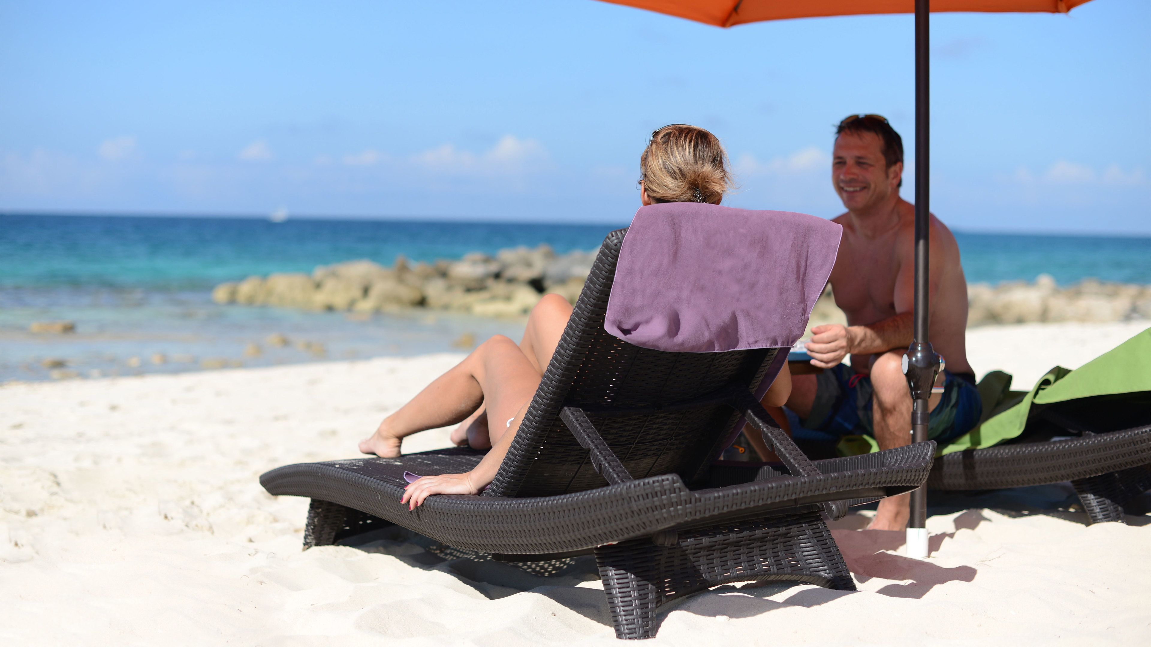 Couple relaxing on beach in Grand Bahamas