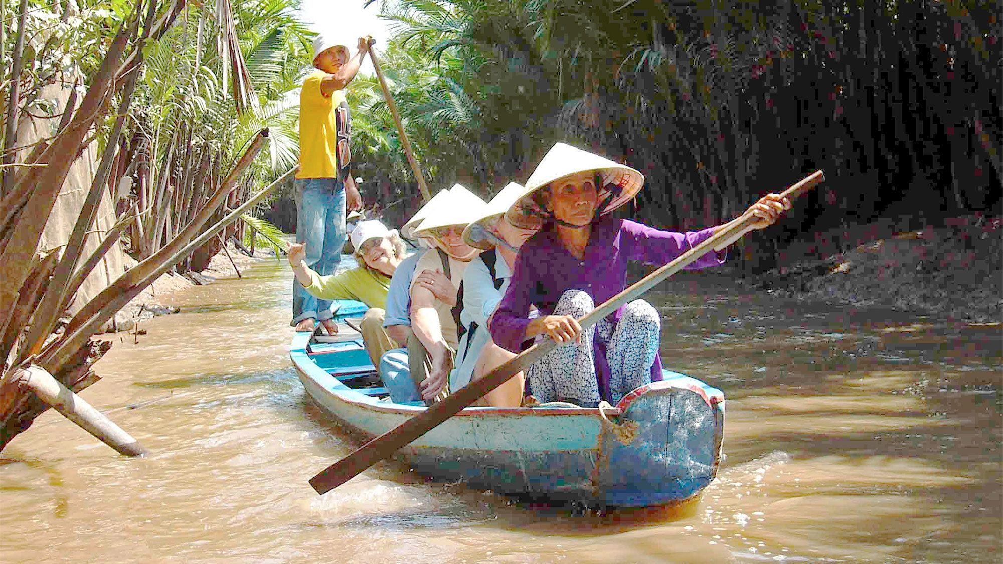 View of a group on a boat tour along the Mekong Delta in Vietnam