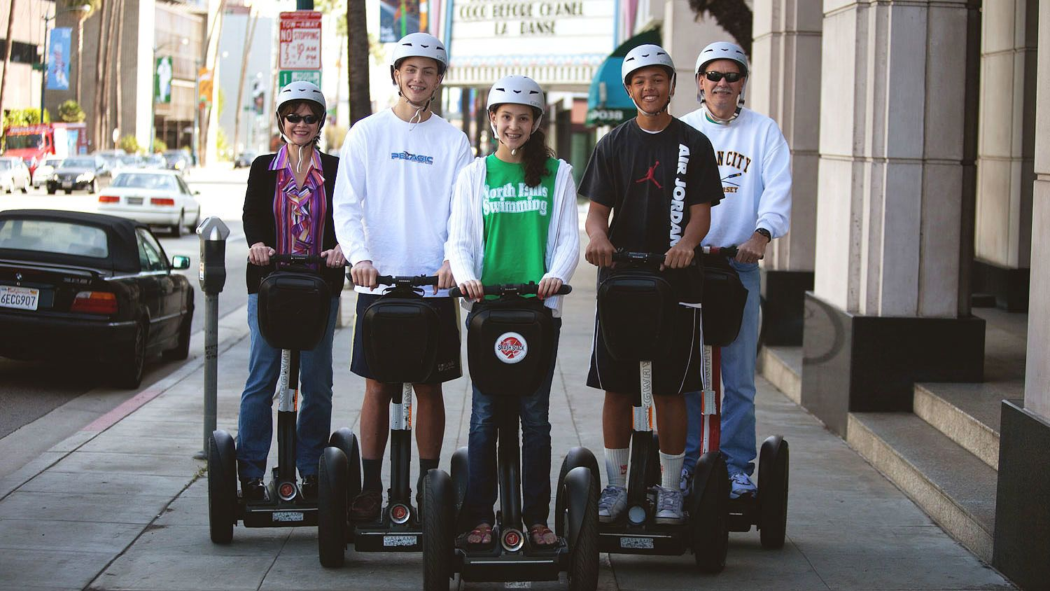 Segway riders on a street in Beverly Hills.