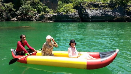 Women in an inflatable kayak on James Bond Island