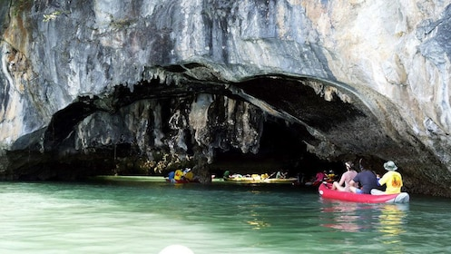 Kayakers near sea cave on James Bond Island