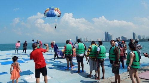 People wait in line for parachuting around Coral Island