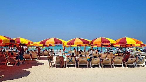Umbrellas and seating on white sand beaches on Coral Island