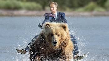 Show item 3 of 4. Comedian riding a bear