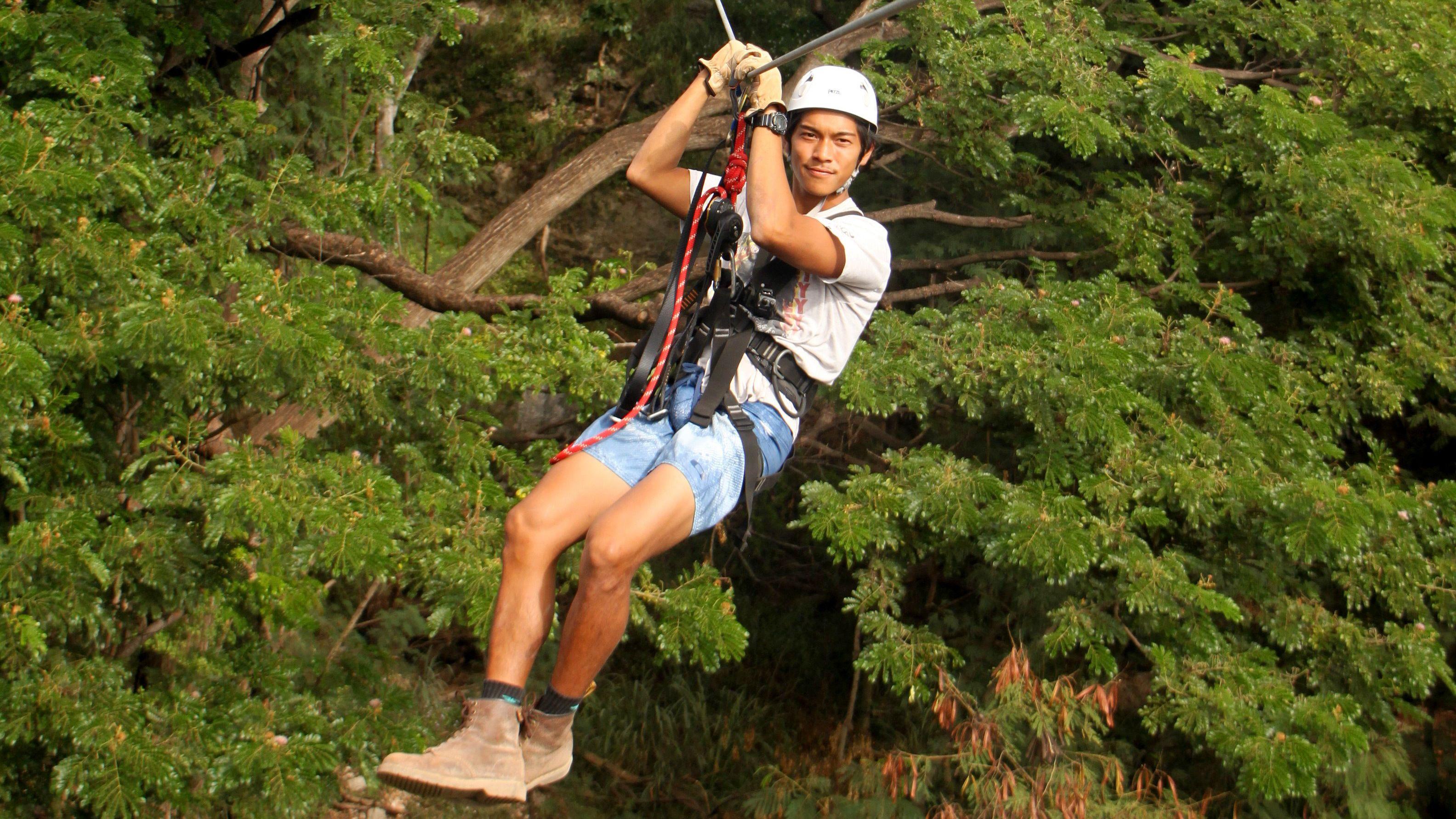 Ziplining man at adventure park on Oahu