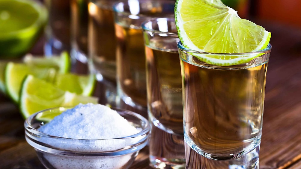 Show item 4 of 5. Shots of tequila at the tequila factory in Valladolid