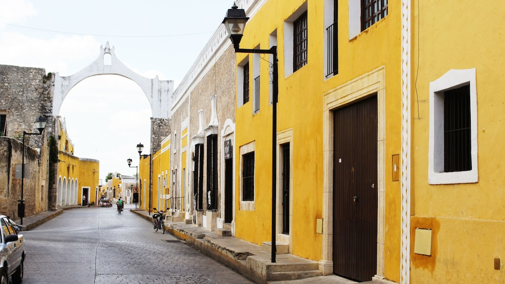 Show item 5 of 5. Yellow buildings line the streets in Izamal