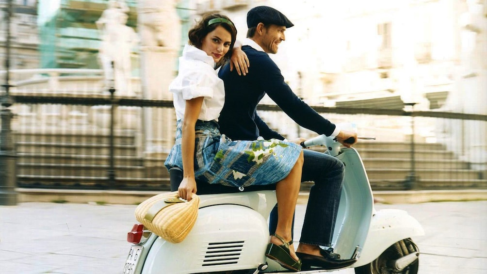 Show item 1 of 5. Couple on a Vespa in Rome