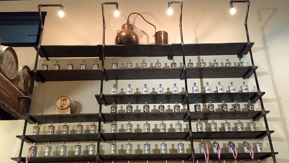 Show item 5 of 5. Shelves with bottles at a distillery in Tennessee