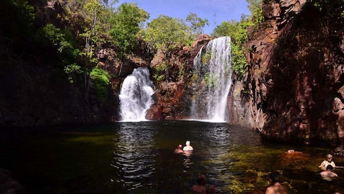 People swimming in the pool at the bottom of Florence Falls at Litchfield National Park in Australia