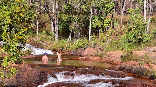 Couple swimming in Buley Rockhole at Litchfield National Park in Australia