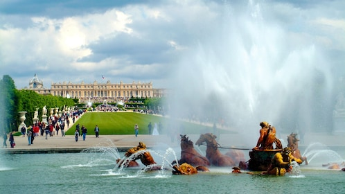 Statues in a fountain at the Palace of Versailles