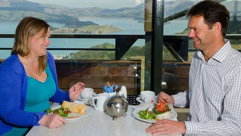 Two people eating dinner in New Zealand