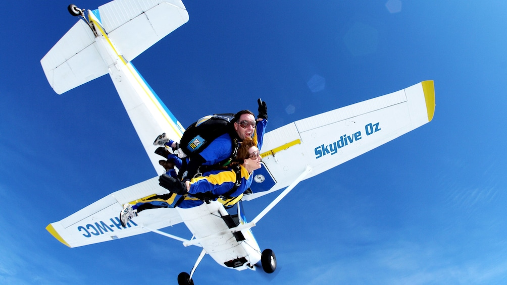 Tandem skydivers jumping from plane over Batemans Bay