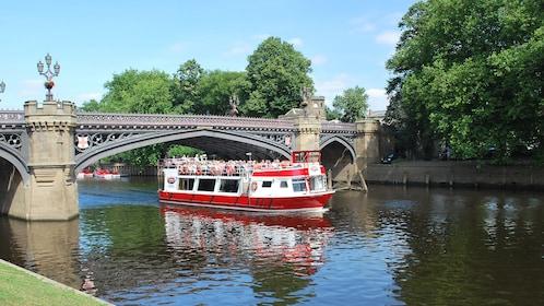 Cruise boat going under a bridge in York