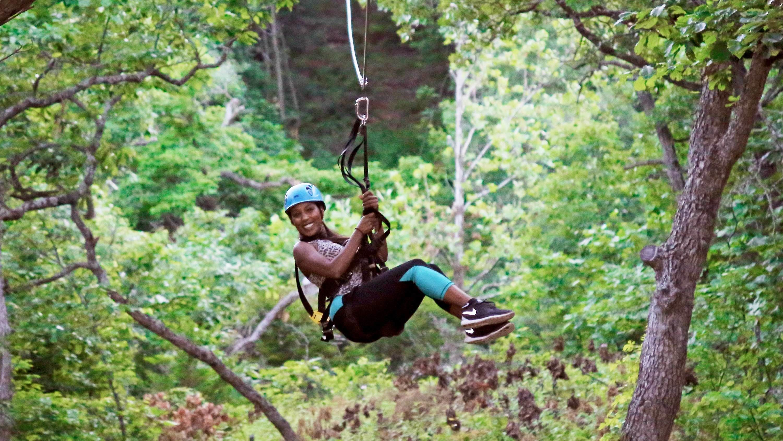 Woman ziplining in Kansas City
