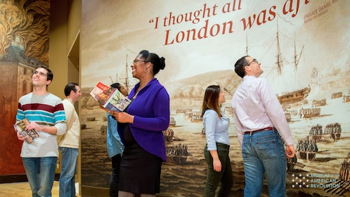 Tourists looking at display at the Museum of the American Revolution in Philadelphia