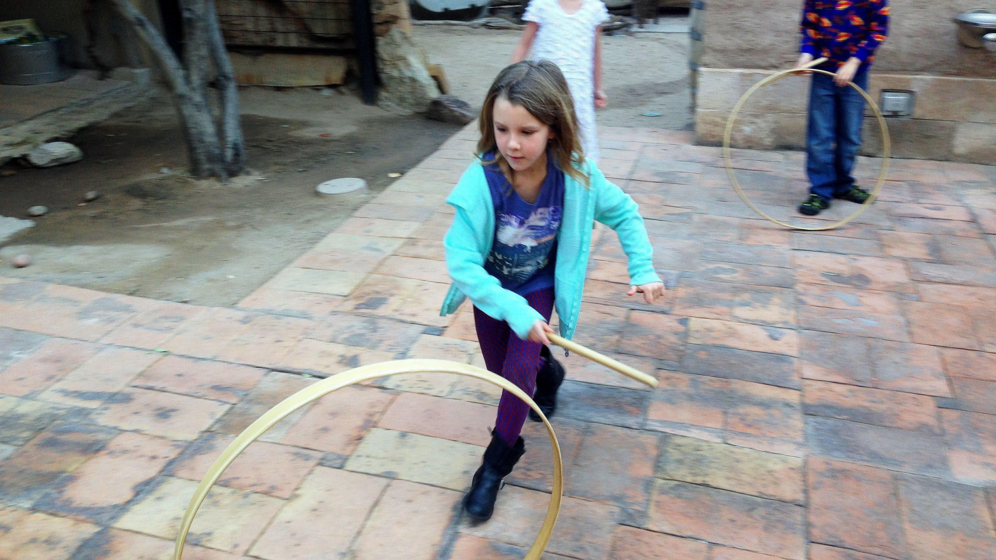 Children play with hoops at Presidio San Agustín del Tucson Museum