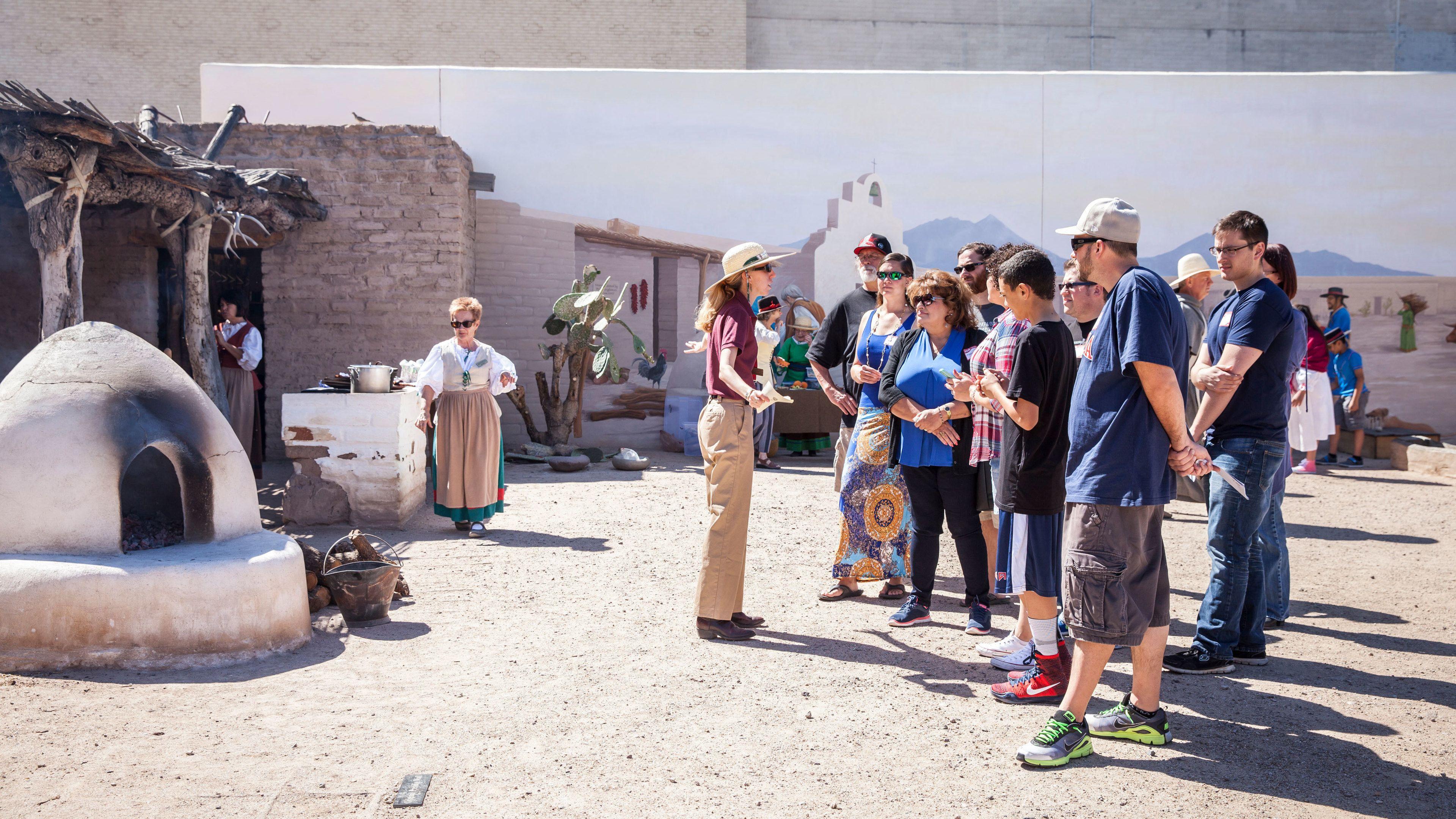 Tour guide leads group around Presidio San Agustín del Tucson Museum