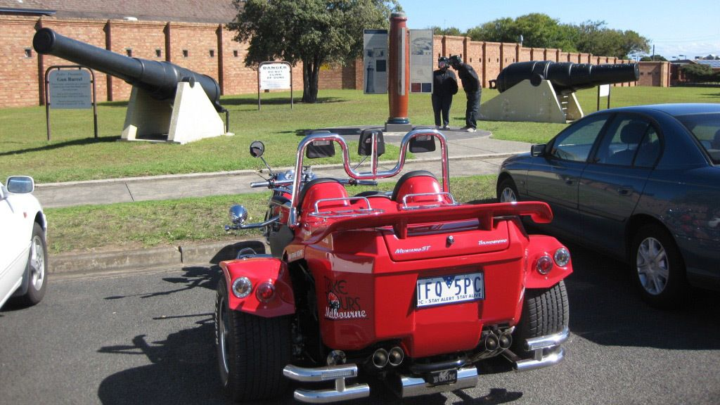 Trike parked at historic site with cannons in Melbourne