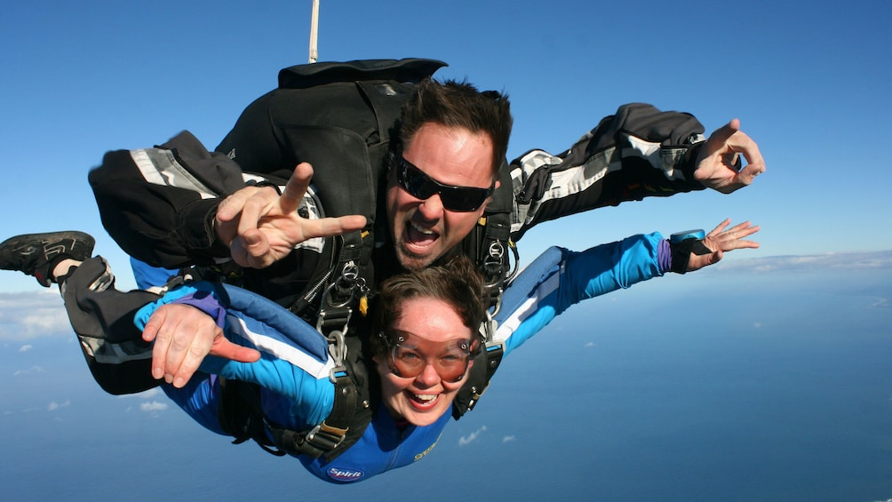 Show item 2 of 7. Skydivers fastened together on the over Coffs Harbour in Australia