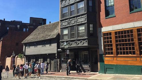 Tourists view Paul Revere's house in North end of Boston