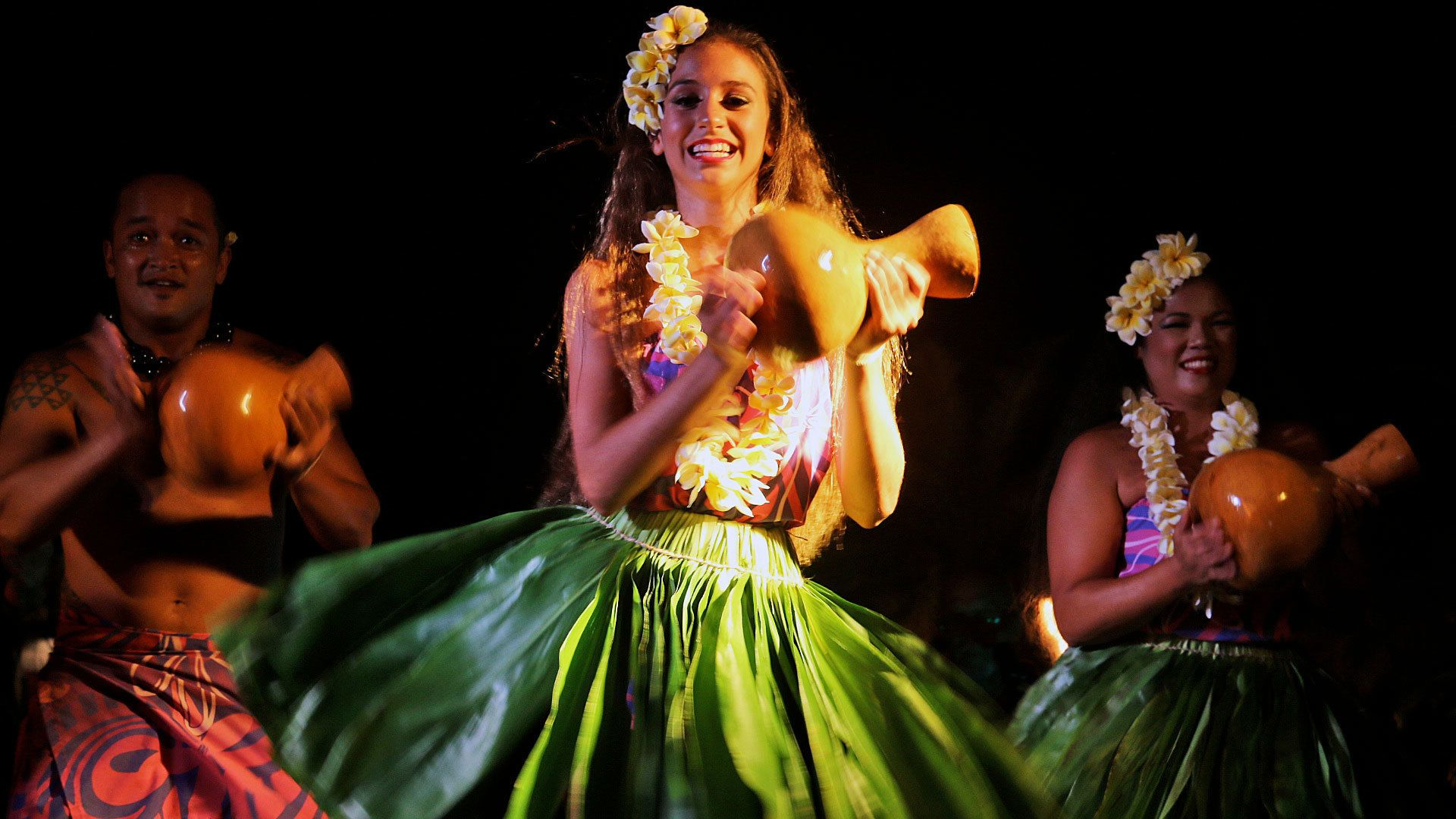 Luau performers in the middle of performance in Kauai
