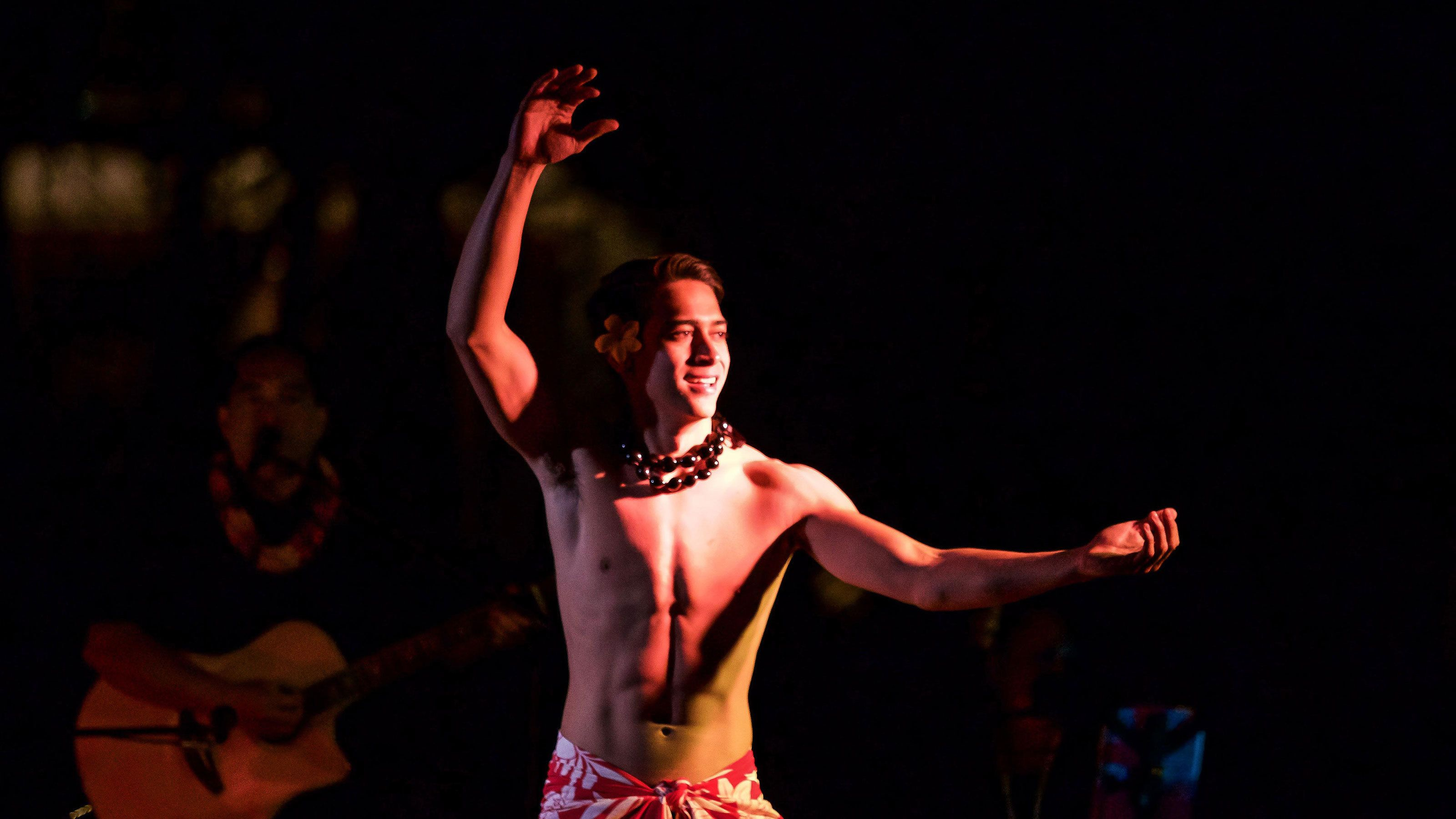 Luau performer in middle of performance in Kauai
