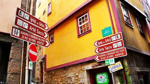 Multiple street signs of different attractions in Porto