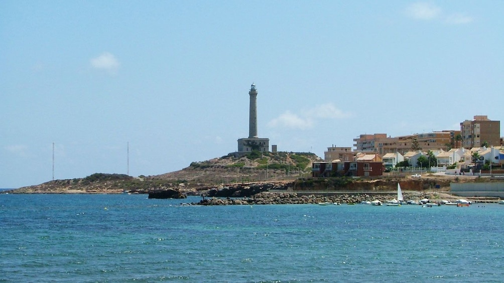 Show item 5 of 5. View across the water of lighthouse in Cabo de Palos