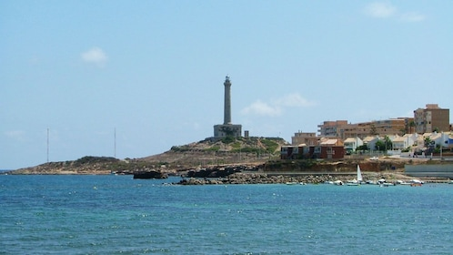 View across the water of lighthouse in Cabo de Palos