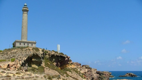 Close view of the lighthouse on the shore edge in Cabo de Palos