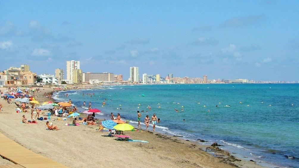 Show item 2 of 5. Beachgoers populate the beach of Cabo de Palos