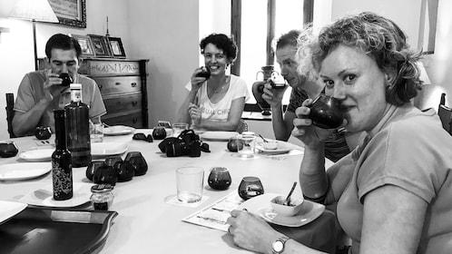 Group smelling olive oil during tasting in Seville