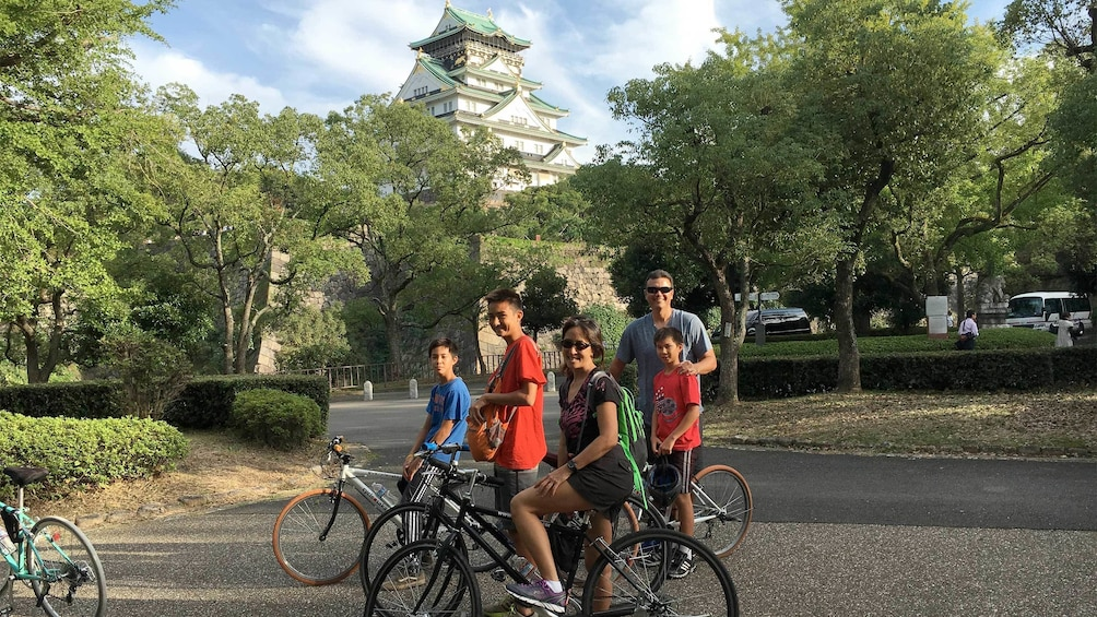 Show item 4 of 5. Family enjoying the Full-Day Cycling Tour of Osaka