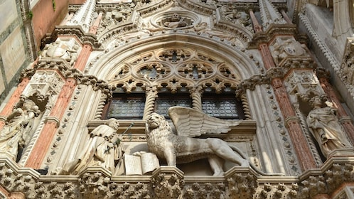 Statues positioned throughout the wall of Porta Della Carta in Venice