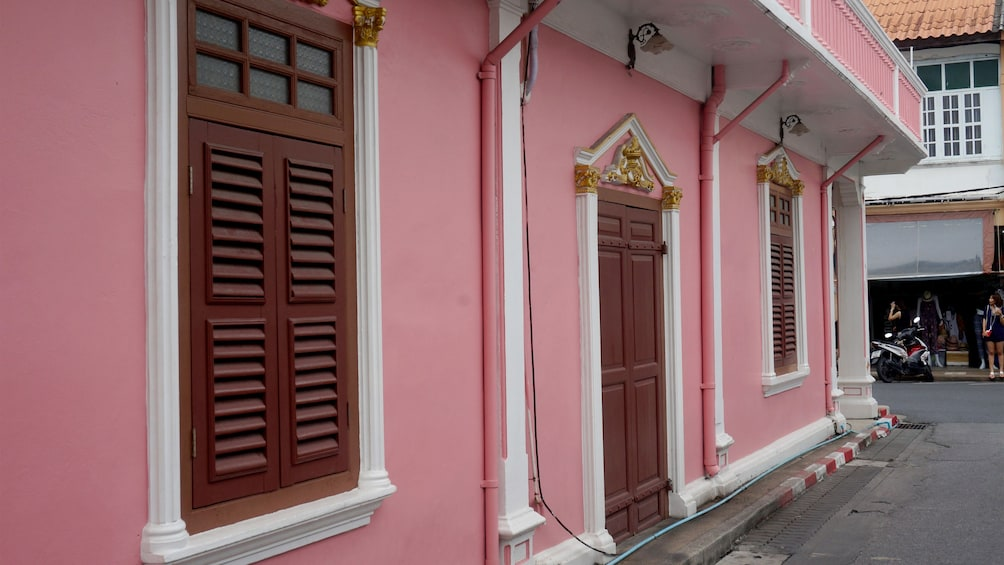 Show item 4 of 4. Pink building in Phuket