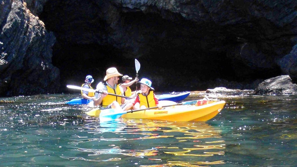 Show item 3 of 7. Group of kayakers paddle around Batemans Bay