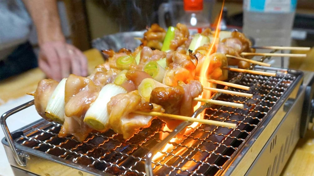 Show item 3 of 5. Kebabs on the grill for the Street Food Cooking Class in Osaka