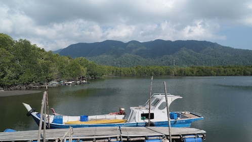 View of boat and waterway before the sun sets for after dark tour in Langkawi
