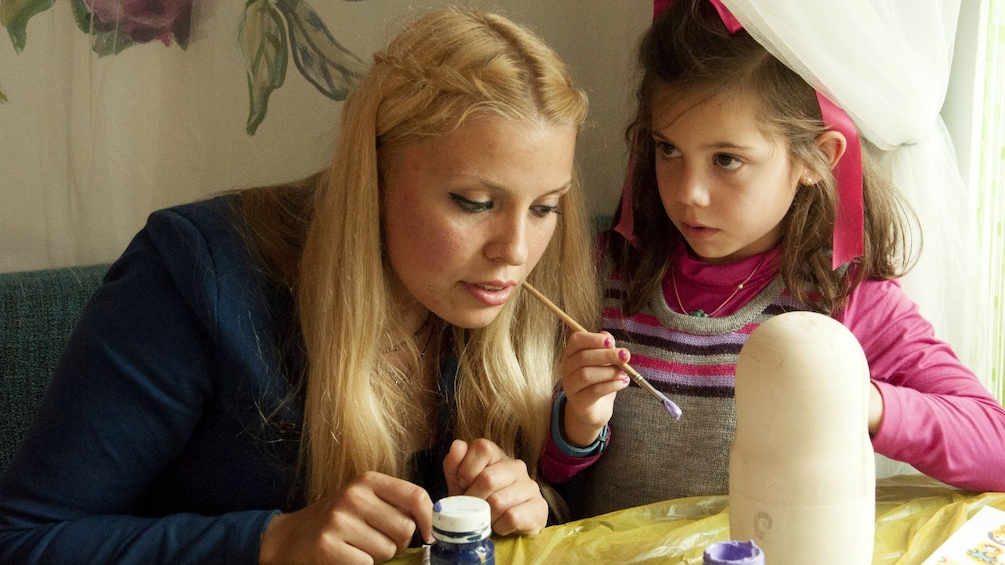 Show item 3 of 5. Mother and daughter in a Matryoshka Doll painting class in St Petersburg